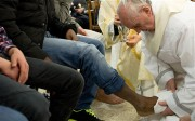 Pope Francis washing the feet of a female, Muslim prisoner.
